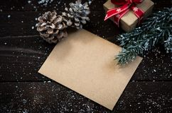 Christmas decoration. Blank card with fir tree,pine cones and gift box Royalty Free Stock Photos