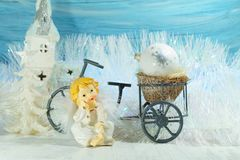 Christmas decoration on a blue background - angel and bike Royalty Free Stock Photo