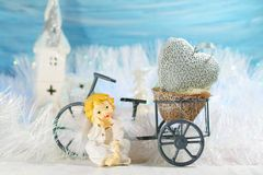 Christmas decoration on a blue background - angel and bike Stock Photography