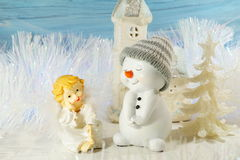 Christmas decoration on a blue background - angel and snowman Stock Image