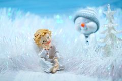 Christmas decoration on a blue background - angel and snowman Stock Photo