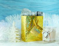 Christmas decoration on a blue background - gifts and christmas candle Stock Photography