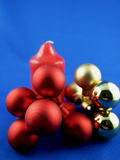 Christmas decoration. On a blue background of red and gold globes royalty free stock images