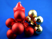Christmas decoration. On a blue background of red and gold globes royalty free stock photo
