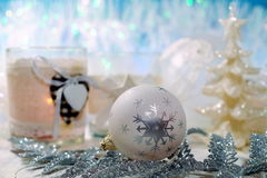 Christmas decoration on a blue background - Tree decoration baubles and christmas candle Royalty Free Stock Photography