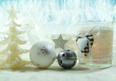 Christmas decoration on a blue background - Tree decoration baubles and christmas candle Stock Photo