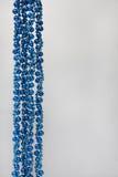 Christmas decoration blue beads on gray background Royalty Free Stock Photo