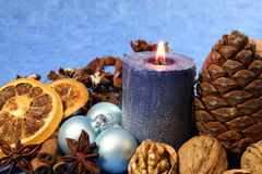 Christmas decoration with blue candle Royalty Free Stock Image
