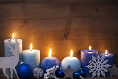 Christmas Decoration With Blue Candles, Reindeer, Ball Stock Photo