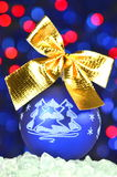 Christmas decoration, blue Christmas ball with golden bow Royalty Free Stock Images