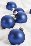 Christmas decoration, blue christmas baubles on white fur blanket Stock Photography