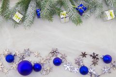 Christmas decoration, blue, green, silver and white. Christmas decoration with shiny blue balls, packets and green branches of Christmas tree on a white Stock Photo