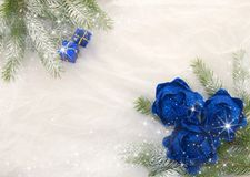 Christmas decoration, blue, green, silver and white. Christmas decoration with shiny blue balls, packets and green branches of Christmas tree on a white Royalty Free Stock Photo
