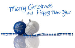 Christmas decoration blue and silver balls. With beads on white with reflection royalty free stock photography
