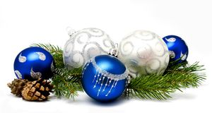 Christmas decoration blue and silver balls with fir cones Stock Photos