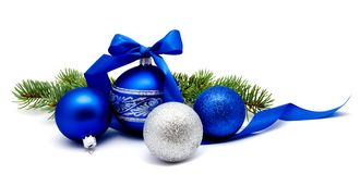 Christmas decoration blue and silver balls with ribbon and fir t. Ree branches isolated on a white background stock images