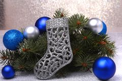 Christmas decoration. The boots of Santa Claus and Christmas tree branches on wooden background royalty free stock photography