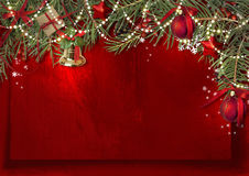 Christmas decoration border with bell, firtree and ball on red p Stock Image