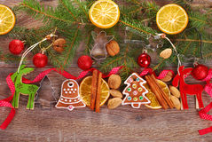 Christmas decoration border with gingerbread cookies and spices Stock Photo