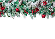 Christmas decoration. Christmas Border. Tree branches with baubles, stars, snowflakes isolated on white stock photos