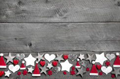 Christmas decoration border in white and red on grey wooden back stock image