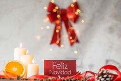 Christmas decoration with bowknot. Christmas decoration with red bowknot and lighted candles royalty free stock photos