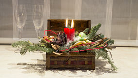 Christmas decoration: box with candles, Christmas tree and wine glasses Royalty Free Stock Images
