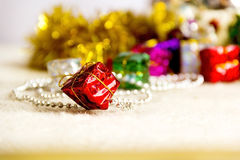 Christmas decoration boxes. Christmas decoration toys close-up on gold background Stock Photos