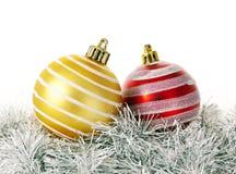 Christmas decoration bulbs. Two christmas bulbs on christmas glitter Royalty Free Stock Photo