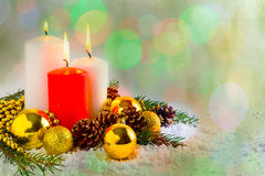 Christmas decoration with burning candles on bokeh background Royalty Free Stock Images