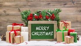 Christmas decoration burning candles chalkboard gift boxes Royalty Free Stock Photos