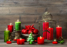 Christmas decoration with burning candles. nostalgic home interior. Christmas decoration with burning candles, baubles and birdcage. nostalgic home interior with stock image