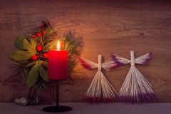 Christmas decoration with burning red candle on table stock photo