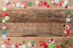 Christmas decoration. Buttons frame on wood background Royalty Free Stock Photos