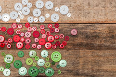 Christmas decoration. Buttons stack on wood background Stock Image