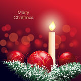 Christmas decoration with candle and bauble Royalty Free Stock Photo