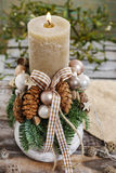 Christmas decoration with candle and cones Royalty Free Stock Image