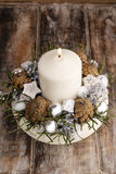 Christmas decoration with candle and cones Royalty Free Stock Images