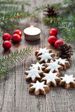 Christmas decoration with candle. Christmas cookies and candle with festive decoration Stock Photos