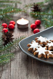Christmas decoration with candle. Christmas cookies and candle with festive decoration Royalty Free Stock Image