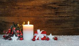 Christmas candle with red gift box and decorations Stock Images