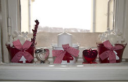 Christmas decoration. Candle, hearts snowflake inside window Stock Image