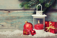 Christmas  decoration with candle. In lantern and fir tree branches on wooden background Royalty Free Stock Images