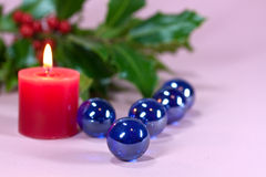 Christmas decoration with candle light,holly. Leaves and berries Stock Photography