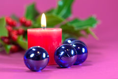 Christmas decoration with candle light,holly. Leaves and berries Royalty Free Stock Photography