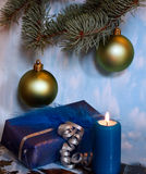 Christmas decoration with candle light,pine leaves. A christmas decoration with candle light,pine leaves and gift Royalty Free Stock Photography