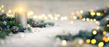 Christmas decoration with candle and lights royalty free stock photography
