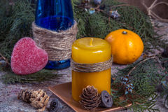 Christmas decoration, candle for New Year, blue glass bottle, ta Stock Photo