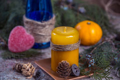 Christmas decoration, candle for New Year, blue glass bottle, ta Royalty Free Stock Photos
