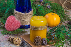 Christmas decoration, candle for New Year, blue glass bottle, ta Stock Photography